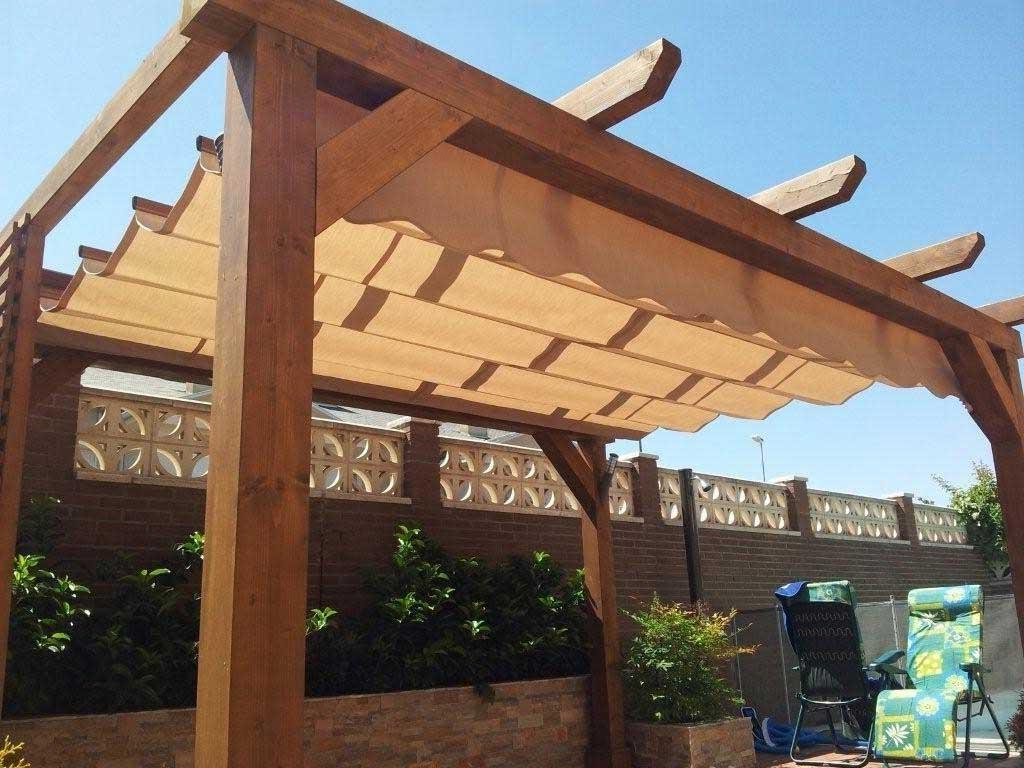 Pergolas de madera de alta calidad en madrid for Guias para toldos pergolas